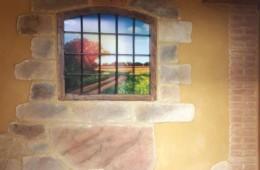 Revestimiento de entrada de vivienda. Tematización en imitaciones piedra y ladrillo, aprovechamos ventana antigua para decoración.
